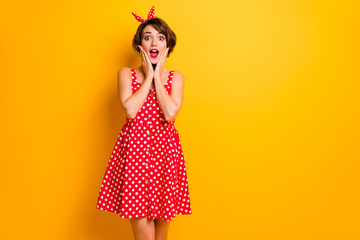 Portrait of astonished girl hear unbelievable unexpected novelty impressed touch hands face scream wear polka-dot skirt isolated over vivid color background