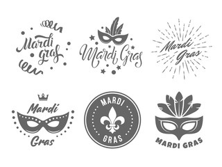 Mardi gras logos. Fat Tuesday badges. Set of vector emblems with handwritten lettering Wall mural