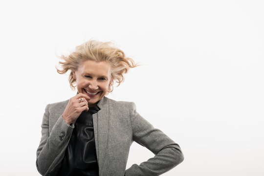 Portrait confident, carefree senior businesswoman