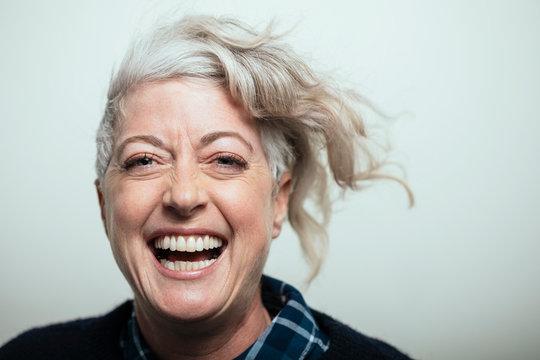 Portrait confident, enthusiastic cool mature woman laughing