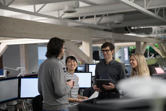 Business people talking, meeting in open plan office