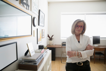 Portrait confident senior businesswoman entrepreneur in studio office