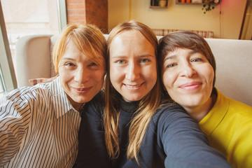 Happy women taking selfie photo