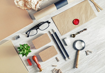 Blank stationery set on light wood table background. ID template. Mockup for branding identity for...
