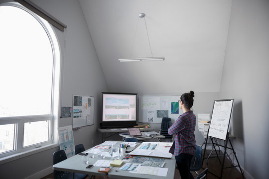 Female city planner working in office