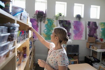 Preschool teacher cleaning classroom