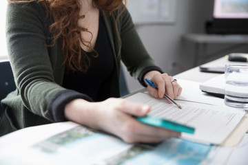 Businesswoman reviewing paperwork contract
