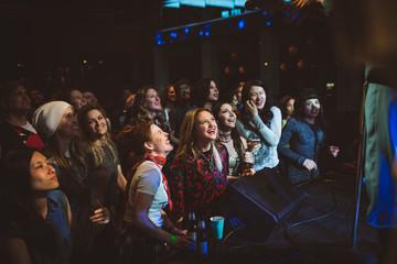 Enthusiastic crowd enjoying music concert