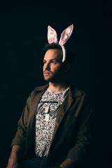 Renaissance portrait thoughtful young male millennial wearing costume rabbit ears