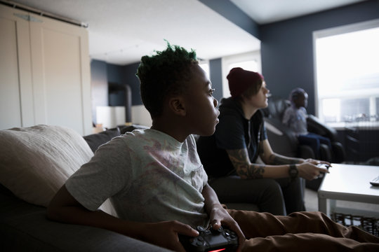 Boy playing video game in living room