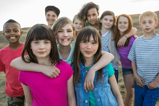 Portrait of happy schoolchildren on field trip