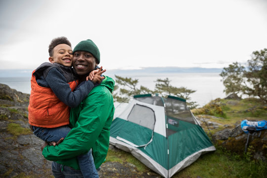 Portrait affectionate father and son camping