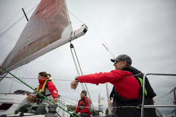 Sailing team training on sailboat