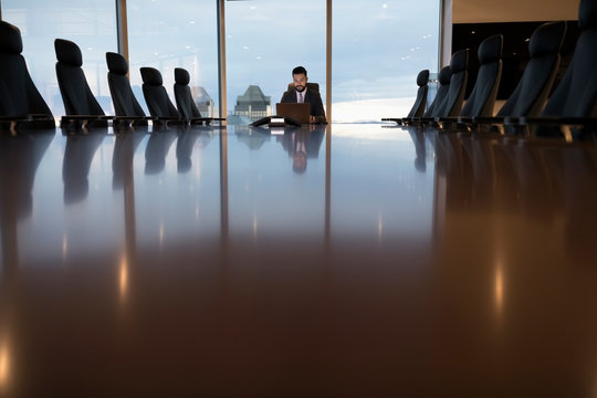 Dedicated businessman working late in boardroom