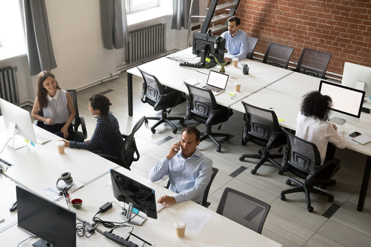 Top view of diverse workers busy working in shared office