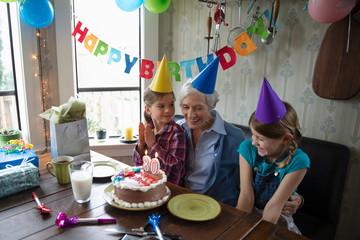 Granddaughters celebrating grandmother's 80th birthday