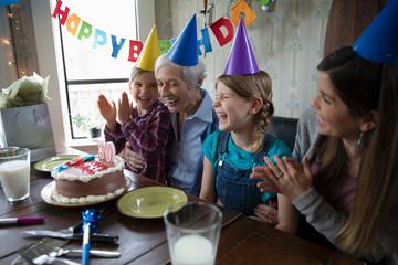 Multi-generation women celebrating senior woman