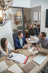 Home builder architects and designers planning in office meeting