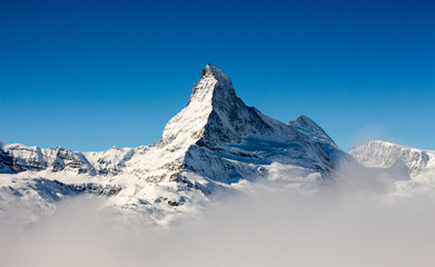 Foto op Aluminium Bleke violet Zermatt Matterhorn view mountain winter snow landscape sea of fog clouds sunset
