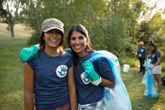 Portrait smiling mother and daughter volunteering