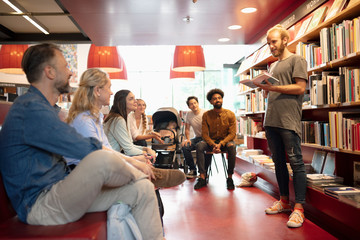 Author doing a reading for small audience in bookstore