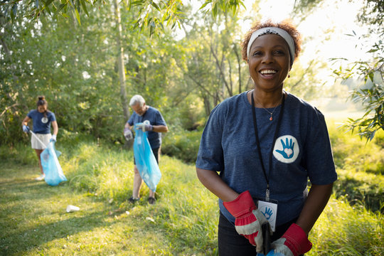 Portrait confident senior woman volunteering, cleaning up garbage in park