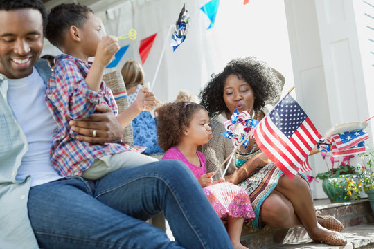 Happy family celebrating Independence Day at home