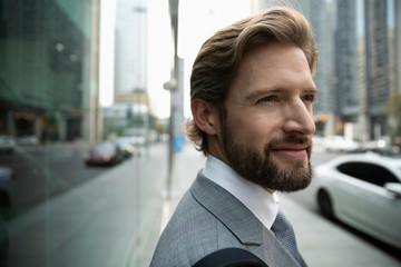 Portrait confident, thoughtful businessman on urban sidewalk