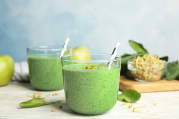 Green buckwheat smoothie on white wooden table