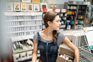 Confident female business owner working in art supply shop