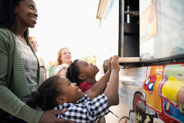 Mother and daughters at ice cream truck