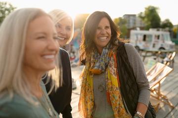 Smiling mature women friends in park