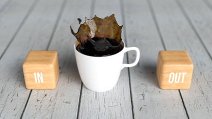 cup of coffee and cubes with text IN and OUT on wooden background