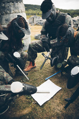 Paintballing team with map planning strategy