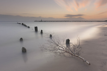Soft waterscape with stick on foreground, made on long exposure shutter.