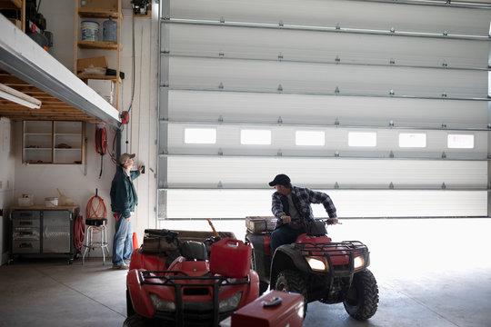 Farmer on quad bike in barn