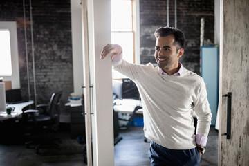 Portrait confident businessman in office doorway