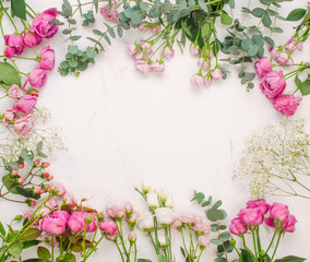 Frame of flowers on white marble background