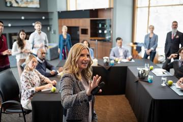 Businesswoman leading conference presentation