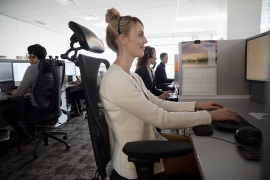 Woman working in cubicle at call center