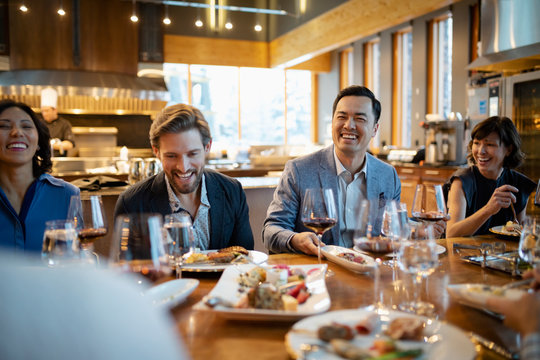 Happy business people dining at restaurant table