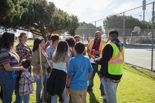 Volunteers meeting, cleaning park