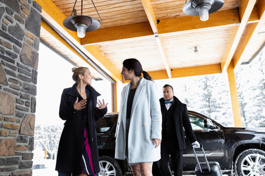 Businesswoman talking, arriving at hotel