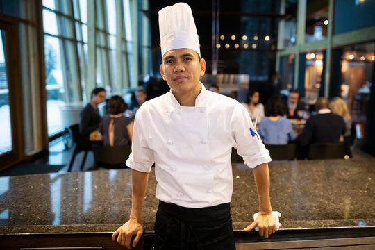 Portrait confident executive chef in restaurant