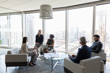Business people talking, meeting in urban office lounge