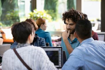 Hackers working at laptops at hackathon