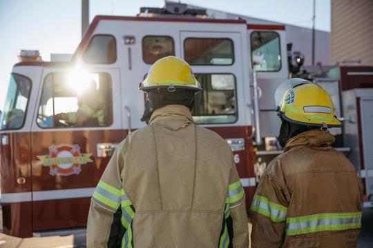 Firefighters walking toward fire engine