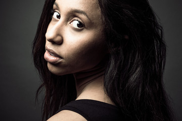 Portrait confident beautiful Jamaican woman with long black hair and brown eyes