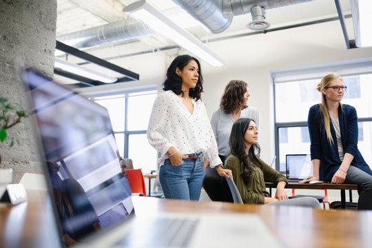 Confident, ambitious businesswomen working in office