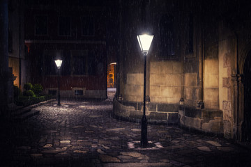 Rainy night in old European city with lanterns Fotobehang